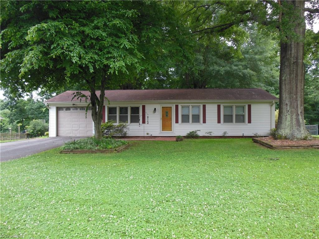 Nice well maintained rancher on large lot. Fenced back yard. Large sun room and over sized brick patio. Maintenance free vinyl siding and replacement windows. Just minutes from Winston Salem. Storage building, refrigerator, washer and dryer remain.