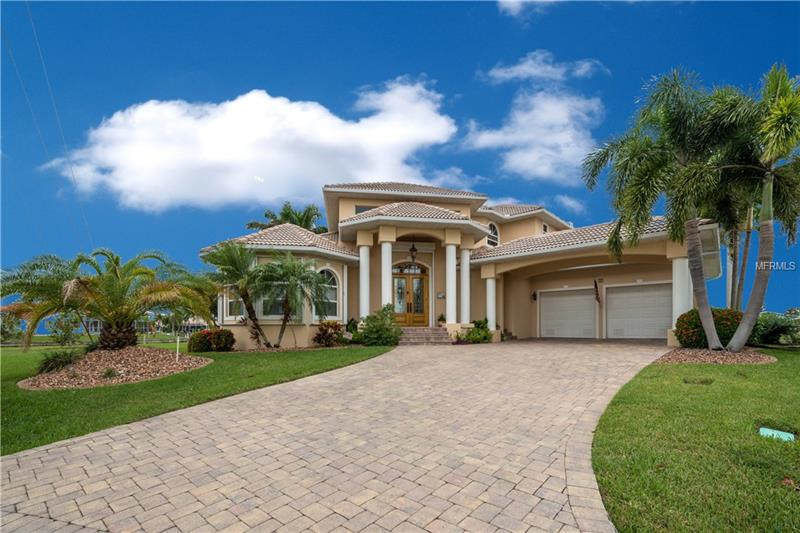 Magnificent custom-built waterfront home with 180 feet of concrete seawall, concrete dock and 2 boat lifts with sailboat access to Charlotte Harbor, Boca Grande Pass and the Gulf!  All of this on a tip lot in the prestigious Punta Gorda Isles!  Imagine the possibilities with  4800+ square feet of living space. Gorgeous entryway w/ glass doors & beautiful staircase. Dramatic living room vault ceilings. You'll love the beautiful Gourmet kitchen featuring custom cabinetry, stainless steel appliances, granite counter tops, breakfast bar, pantry closet and breakfast nook.  The kitchen opens to living area and sliders leading out to spacious outdoor living spaces with gorgeous views of pool, spa and canal. Master suite and a spacious second bedroom both located on the 1st floor. The 2nd level features a third bedroom and an office w/ elegant French doors leading to the balcony for premier views of pool and canal.  Family gatherings and memorable evenings with friends are perfectly accommodated in this extraordinary home.