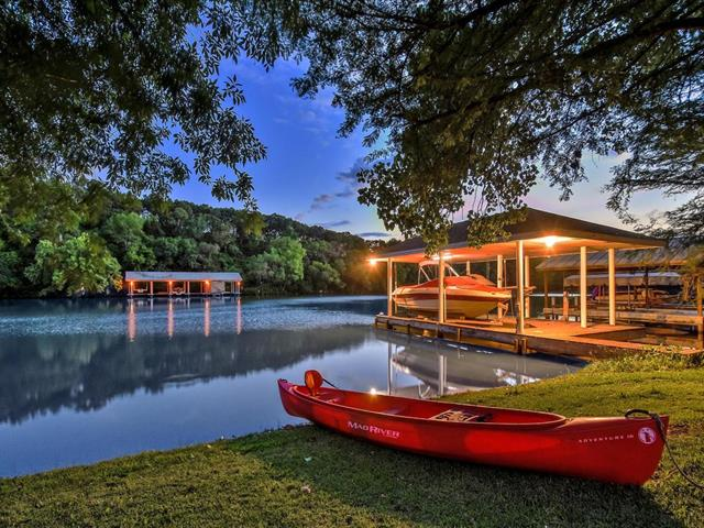 Panoramic lake views w/ 85+/-ft of tranquil Bull Creek just off the main basin of Lake Austin! You won't find another property like this one! Situated on 2 unique lots w/ lush mature oaks, PRIVATE boat dock stores 3 jet skis & 1 boat+lift. Ultimate home for entertaining, heated pool/spa w/ fire pit. Enter through stone courtyard for ultimate privacy w/ custom water feature. Main level entry really highlights views, master, kitchen, formal dining & living on main.