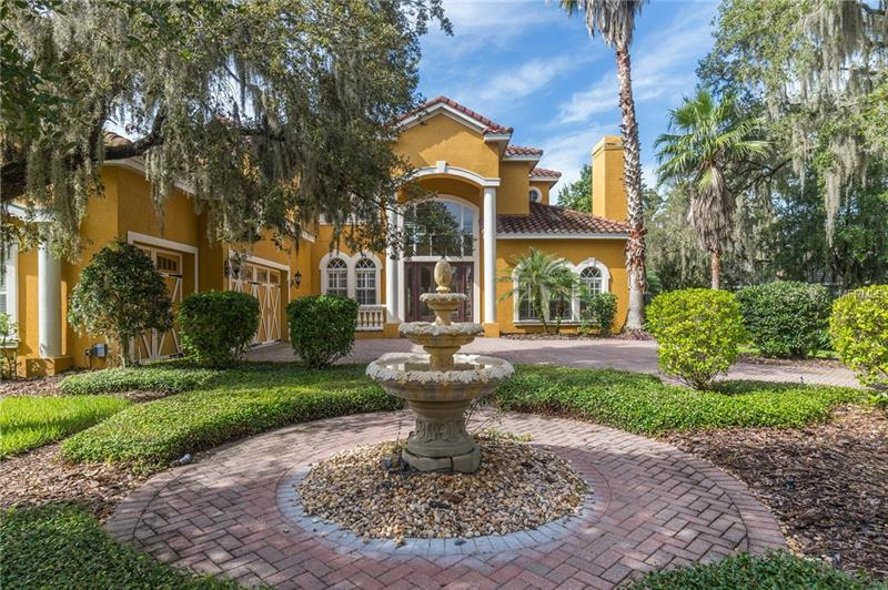 """Amazing ½ Acre Cul de Sac Estate overlooking Pond in Gated Avocet! One of the BEST Lots in Fishhawk in Cul de Sac w/Pond view that is far enough away to treasure on Half Acre sprawl! Custom Hannah Bartoletta Tile Roof home w/Magnificent Grand Paver Courtyard Entry w/Oversized 3 Car Garage! Grand Foyer Entry soaring 30 feet greeted by wood floors & Circular Stairs to 3 Secondary Bedrooms. Formal Sunken Living Room w/Gas Fire place! Formal Dining Room is elevated Elegance offset with Pillars! Sunken Great Room w/30 Foot Ceilings & French Doors to Pool/Spa Entertaining area! Kitchen is cooking dream w/Granite Counters, 42"""" Cherry Cabinets & Bay Breakfast Nook w/Mitered Glass overlooking Pool/Spa and cherished Private Estate View! Pantry will not disappoint you as it takes 2 turns to see it all! Master Bedroom is on First Floor w/Sitting Room area, Dedicated AC system for Master Suite, Master Bath adorned in Granite has His & Hers Counters, Deep Garden Tub & Oversized Walk-in Shower, Master Closet is ample w/2 Sides & Separate Linen closet. Large Office on First Floor w/ Half Bath w/dual access to hall or Office to be offered to Guests. Dedicated Laundry Room w/Cabinets & Sink! Dual Stairs to upstairs, Front Stairs & Backstairs by Kitchen/Laundry Room. Upstairs there are 2 Bedrooms Oversized w/ Full Bath.  3rd Bedroom Suite is split w/Full Bath that has walk-in Shower! Bonus Room w/Closets has many options due to the Grand size!  Pool/Spa is a Grand Entertaining area w/Dedicated Half Bath & Shower Area!  The home has lots of storage and privacy.  Fruit trees include Guava & Citrus tree.  This home zones to Bevis Elementary, Randall Middle & Newsome HS. The Community Amenities are hard to beat here in Fishhawk Ranch, Club Houses, Pools, Game Rooms, Movie Theater, Gym Facilities, Tennis, Basketball, Softball, Hockey, 33 miles of Nature Trails to enjoy and so much more."""
