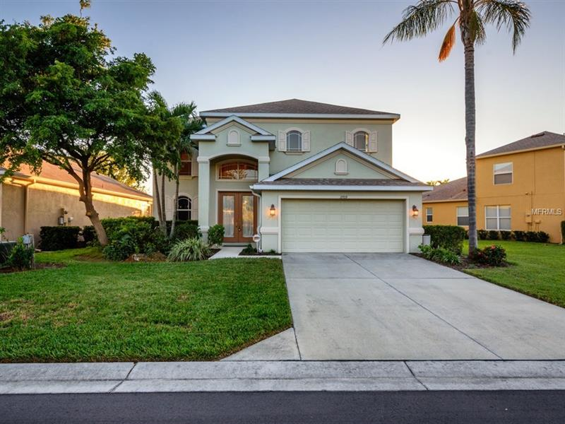 UPGRADED RESIDENCE W/ LONG LAKE VIEWS!  Open plan w/ 3-4 bedrms, 2.5 baths & a bonus rm.  The association covers your lawn care and it has lots of extras; a glass double door entry, furniture quality built-ins w/ glass inserts, granite, ceramic tiled flrs, plantation shutters, custom shades, arched doorways, designer fixt & fans, volume & tray ceilings.  Foyer w/built-in granite hutch.  The formal Dr w/built-in granite buffet.  Kitch. w/ a huge island has 2 pantries, white cabinetry, granite counters, bkfst bar, cook top &  GE Profile SS appls.  SGD overlook paver lanai & lake view in Lr.  MBr w/lanai access, water view & 2 walk-ins.  Solid surfaces, individual vanities w/ dual sinks, a soaking tub & a sep glass shower in MBa.  Double doors offer privacy in the den or Br4 w/ a walk-in closet or alcove that maximizes the storage space beneath the stairs.  An ornate wood & iron staircase to 2nd flr.  Sreened lanai features a covered entertainment area, a heated pool w/ therapy jets, spillover & paver brick surround.  It already has electric & is plumbed for a summer kitchen.  Added bonuses include wireless security system, zoned a/c, a Rain Soft water filtration system & a hurricane rated garage door.  Nestled in Palma Sola Trace where your association fees cover your lawn maintenance, plus community amenities; fitness center, swimming pool & clubhouse.  The location is just minutes to the beach, golf, shopping & dining options.