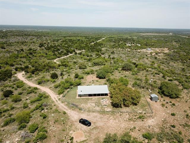 Secluded Hilltop Hide-a-way on approximately 174 acres. Tremendous views.  There are 2 prominent hilltops with large oaks and mesquite trees throughout the property. Good natural grasses and excellent game cover with abundant deer and other wildlife. A 30'x40' pole barn for storage of equipment and feed. Excellent access from US Hwy 87, 16 miles N of Mason, 62 miles N of Fredericksburg and about 1.5 hours drive to Austin/San Antonio. Multiple vineyards in the area. Great hunting ranch.
