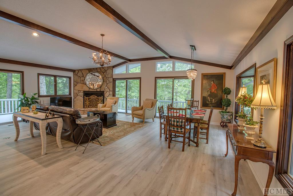 "Highlands Falls Country Club is in a Renaissance, and this property certainly joins the parade.  Upon entering the residence, ascend the entrance stairway to the magnificently remodeled Great Room.  You'll immediately notice the lightness and brightness of the main living area which flows comfortably into a kitchen renovation with all the details decorated in the same neutral pallet and includes top-line appliances and quartz countertops. Part of what makes it special, is the newly laid custom California waterproof flooring throughout the home.  It says ""Mountain-Chic"" loudly.  Sliding doors to the decks from both the Family room and Master Bedroom bring the outdoors in, and the decks overlook the serenity of a large & terraced garden area with stone walls.  Add to this, being just 2 miles from Main Street Highlands which is why Highlands Falls Country Club has a high concentration of year-round residents.  The Nantahala National Forest, Waterfalls, and and Wildlife Habitat second to none ...make Highlands Falls the place to be.  Highlands is often called ""The Aspen of the East"".  Four Seasons, 20-degrees cooler than the flatlands, cultural assets, unique specialty retail, a Relais & Chateau Inn, and the amazing restaurants make this town the perfect setting for your investment in an exceptional lifestyle."