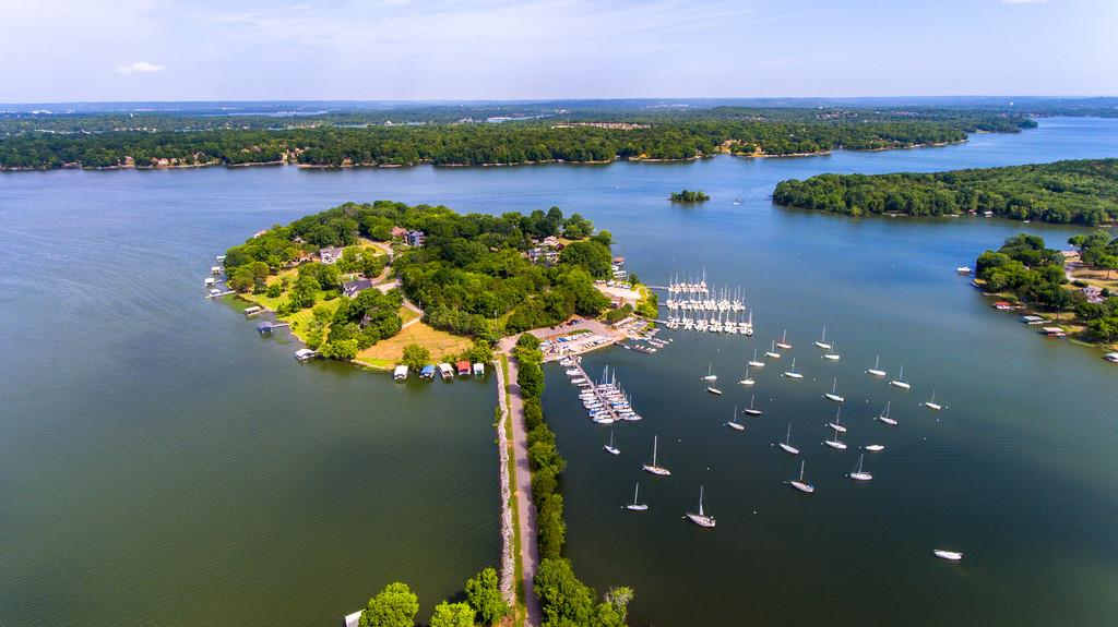 Rare Opportunity to live on Majestic Harbor Island with sunset views. Renovated home features 185' of lake frontage,  32x22 covered dock, 2500 sq ft of decks/patios, and one of the largest single lots on the island. The professionally designed gourmet kitchen, lake views in each room, and multiple doors to decks make this an entertainers dream.