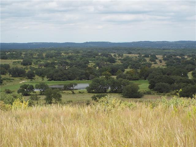 Beautiful 10.01 acres with extraordinary views! Property sits at the in of the cul-de-sac and backs up to a large private ranch, overlooking land where the longhorn roam. The Summit of Cypress Mills is a gated subdivision, with paved roads, underground utilities and wildlife exemption in place, for low property taxes which are currently $295/year.