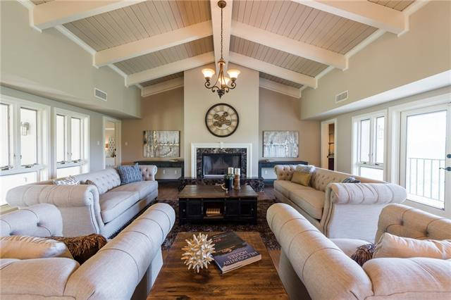 Steal this Deal ASAP - Multi-Gen Custom Retreat-panoramic views in Golf Course community. 2018 appraised>$1M lowest $/SF. Feels like a vacation home, yet only minutes to City Center, Lake Travis & top rated schools. Versatile floor plan great for multi-generation/guest/nanny/income producing/vacation rental. Home sits on a double lot,each side has its own entrance, kitchen, master suite,2 bedrooms living, dining, utility, storage building, balcony and patio. No HOA, low taxes. Book your showing today!