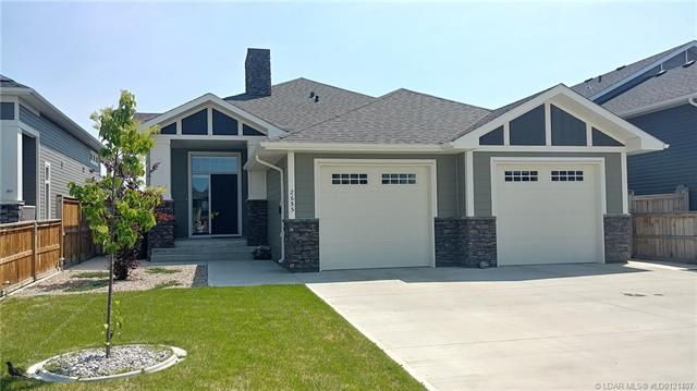 This exceptionally well built 1233 sq ft bi level home boasts 2 large heated garages (one attached) and one detached, 28' deck off dining room partially covered with sheltered BBQ area, granite countertops throughout entire home. High end Normandeau window blinds, ensuite shower has river rock base and tons of storage, walk through closet to large main floor laundry room. Home is loaded with huge bright windows, vaulted ceilings, skylights and east facing backyard make entertaining your friends a dream, lots of sun and out of the wind. Close to the Cottonwood Park where kids can skate on the outdoor rink or play basketball in the summer. Land O' Lakes golf course is just a 3 minute drive away.