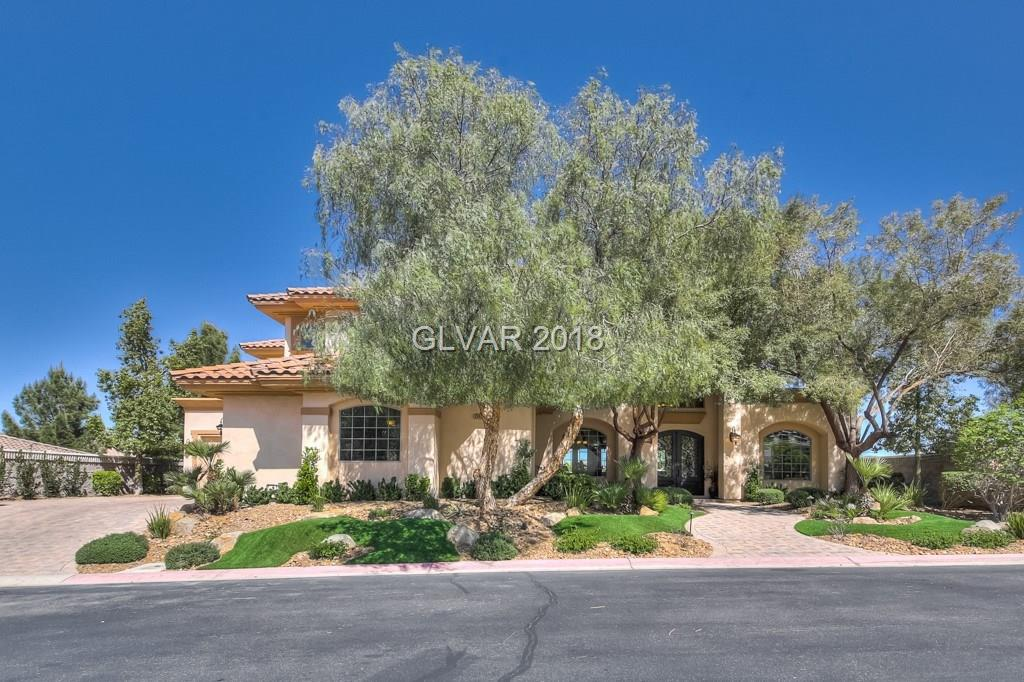 7 hills stunner. Master suites(1 up, 1 dn). Master up w/balcony w/ strip & mtn views, 2 walk in closets. Gourmet kitchen w/granite, island w/veg sink, custom cabinets, SS appl, secondary farm sink, 3 dishwashers, double ovens, wine fridge, butlers pantry. Dual staircases, 2 laundry rooms. Elevator. Casita w/bath & fireplace. Backyard oasis w/covered patio w/pool & spa w/rock waterfall. Built in BBQ w/fridge/grill, firepit