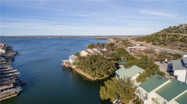 Lake LBJ Waterfront Home-Kitchen w/ granite counters, many cabinets, & glass cooktop. Views from dining. Living w/ natural light & hall bath. Master w/ water views, secluded deck & en-suite bath w/ tub. Guest room on main floor. Dumbwaiter for transport. Two guest rooms w/ Jack & Jill bath. Covered porch for watching sunset. Fish, sunbathe, swim from dock. Watercraft lifts, boat house, & boat stall w/ elec lift for easy lake access. Horseshoe Bay Resort & amenities are just a quick ride away!