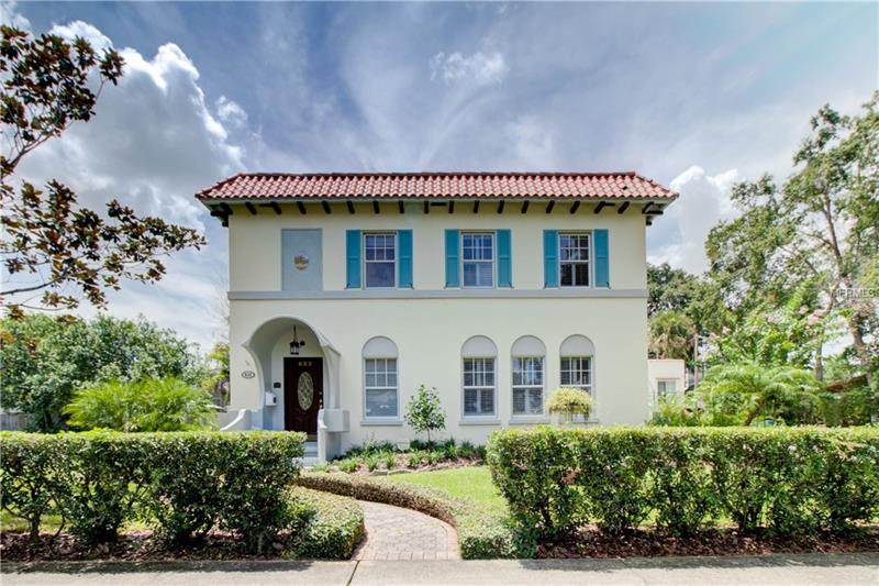 JUST REDUCED! MUST SEE. Luxury Abounds Estate Style Home with a Guest Carriage House combined on 2 lots located in the heart of Downtown Orlando in the sought after neighborhood of Lake Eola Heights Historic neighborhood. The Carriage House is an income producing property with a 2/1 upstairs and a 1/1 downstairs plus additional storage area. The Historic Main House has 4 bedroom, 3 1/2 baths, Formal Living Room w/cut Coral Gas Fireplace. Restored Oak wood Floors with inlaid design throughout, Formal Dining Room with Original Cuban Tile floor, arched entries, High Cove Ceilings, Gourmet Kitchen with Granite counters, Custom wood cabinets, built in desk and pot rack. Kitchen Opens to a custom sitting area and steps down to a large open Florida Room with stone walls, high Wood Beam ceiling Overlooking Tropical Garden Lagoon Style Pool/Spa area with waterfall. A large oversize laundry/pantry room is off the kitchen area with basement area for additional storage. Located on the back of the second floor is a large 36' x 10'  enclosed Porch area. Upgrades include Unique Detailed ceilings, Deep Well w/Irrigation system, ceiling fans and skylights. This UNIQUE OPPORTUNITY boasts all the amenities and walking distance to the Downtown Lifestyle with Restaurants and Nightlife for your convenience.