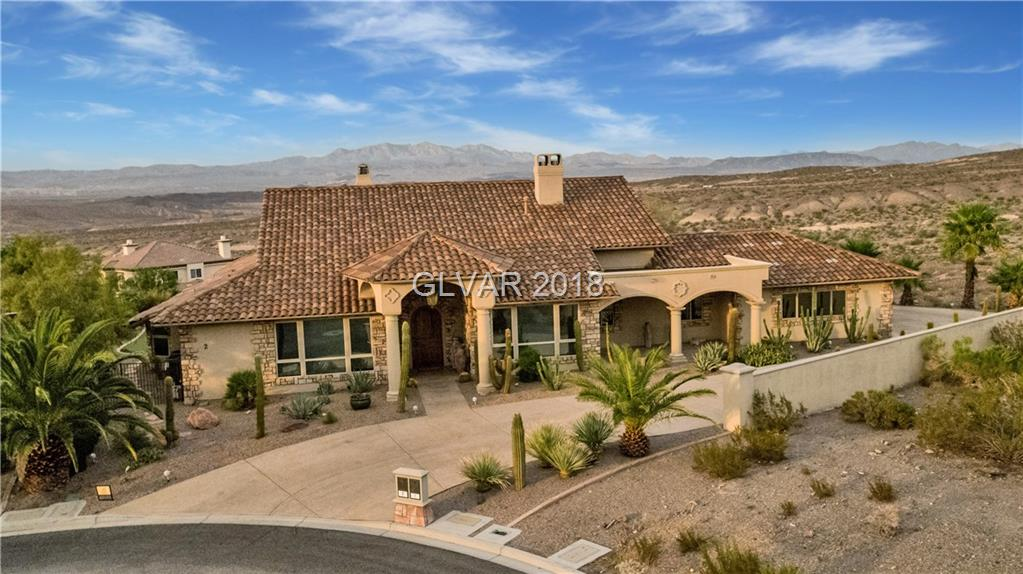 STUNNING ONE STORY HOME with PANORAMIC VIEWS as far as the eye can see of Lake Mead Nat. Park.  Located in the Hidden Oasis of  GG South Shore at Lake Las Vegas, a most beautiful & prestigious community to those in the know. This Italian styled resort home is 3495 sq ft has 3 bedroom ensuites. Spacious open floor plan, HARDWOOD floors, granite kitchen, high-end appliances & design throughout. Magnificent beach entry pool. Calm serenity abounds.