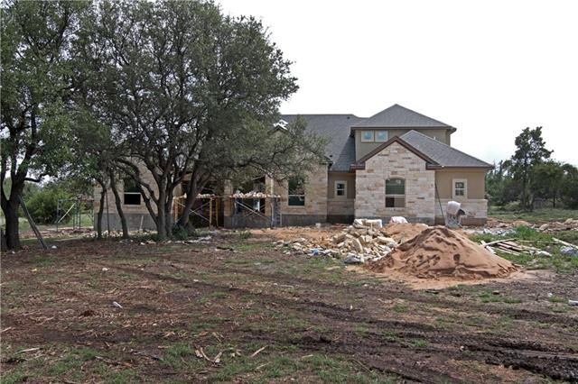 Washington plan on once acre lot featuring a 4 car garage, study, formal dining, wood beams in family and master bedroom. Huge covered patio with fireplace and built-in kitchen.  Bonus room and bath upstairs, private cul-de-sac lot.