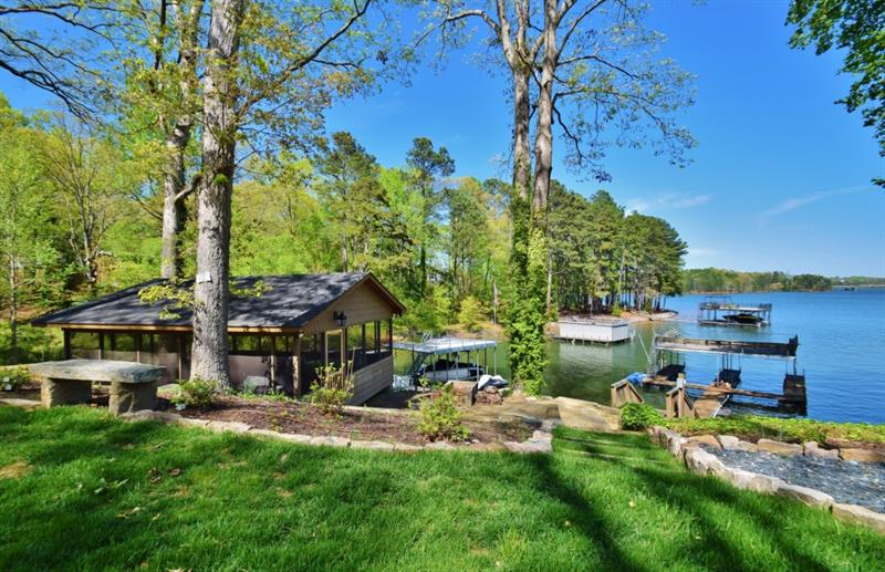 "Perfect views of Lake Lanier from this 4 sided brick ranch. Situated on over an acre just moments from Chattahoochee Country Club, this classic home offers it all! Hardwood floors, updated kitchen, 3 fireplaces, and large sunroom perfect for soaking in the lovely view. Each bedroom on the main level features it's own bath! The finished terrace level offers a rec room, 2 ""bunk rooms"" and 2 be3drooms, along with a full bath. Enjoy the screened porch right at the shoreline, a RARE find on Lake Lanier."