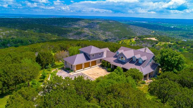 """""""Mi Cielo""""- sitting on Top of the Texas Hill Country with forever views of Long Mountain, Packsaddle, and Lakes Buchanan, Inks, LBJ! Over 5900 square feet of elegance and privacy sit on 2 acres with Homestead Exemption, and in front is a 5 acre parcel to insure that no one can build in front. Adjoining the Homestead is a 26 acre parcel with a Wildlife Exemption. Another 38 +/- acre parcel with AG Ex and 4 stall MD Barn, and 20 acres of improved pasture. Deeded Boat Slip on LBJ with storage area and lift."""