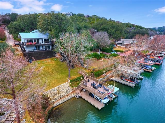 Welcome to Lake Austin waterfront living! Room for all of your family and friends, with 5 bedrooms and 4 bathrooms! Chefs kitchen, hardwood/travertine floors, Anderson windows, walls of windows to capture the breathtaking views! Great for entertaining, low slope lot to the lake, and your private two-level dock with a boat lift & double jet ski lift awaits! Also located in the highly sought after Lake Travis ISD! 