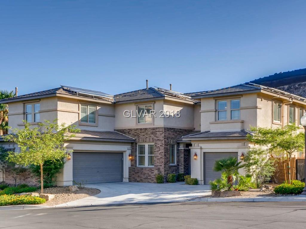 Absolutely stunning 5 bedroom home on huge cul-de-sac lot backing open mountain views. OWNED Solar voltaic system has electric bills averaging under $125 mo! Plantation shutters T/O, B/I 56 bottle wine cooler, Game room w/ surround sound, crown molding T/O, fire sprinkler system, solar pool heater, B/I BBQ island w/fridg, b/i patio speakers, low maintenance landscaping artificial turf in back yard, GE Monogram SS appliances