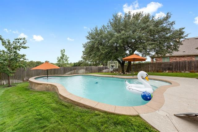 Large free form saltwater pool backyard oasis on private lot and room for playscape and or trampoline.  Large covered back patio with Koolcote and patio surround is Koolcote as well.  Must see home - it's move in ready.  Highland Homes Two Story in Whitestone Oaks of Cedar Park. 5 Bedrooms; 4 Full Bathrooms; 2 Bedrooms Down (Master Bedroom and Second Bedroom); 3 Bedrooms Upstairs; 2 Gamerooms Upstairs; 1 Media Room Upstairs; 1 Office Downstairs.  Backs to farmland.  Original owners.  Lot is in cul-de-sac.