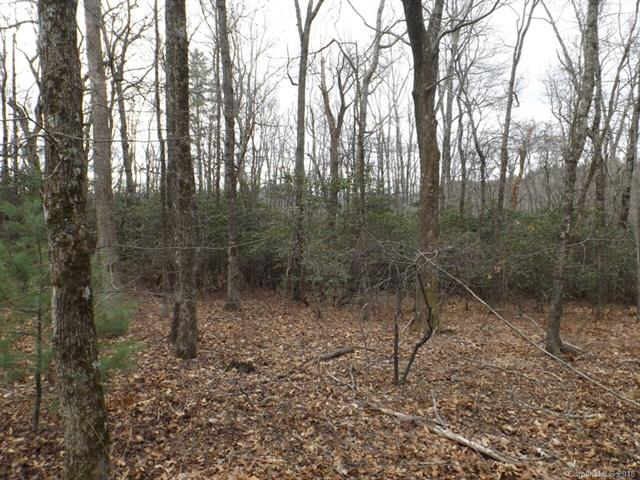 Beautiful private lot in Gated Community . Gentle sloping wooded lot on private cul-de-sac makes for a favorable building site with easy access. Survey and septic permit complete and ready for build.