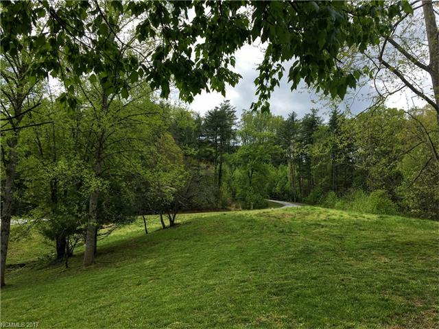 Are you looking for a lot with long range views, mountain views or a grassy knoll to build your dream home? Come check out the gated community of Hutch Mountain Estates. With many different lots to choose from, you have the ability to pick the perfect one for you. Lot sizes range from .8 acres to 1.7 acres, with prices starting at $15,000 up to $95,000. Located in Fletcher with easy access to Hendersonville and Asheville. Great community with completed homes. Lot #14 includes .96 acres.