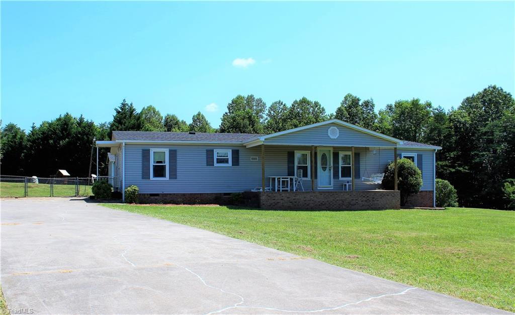 Good condition home out in the country with concrete driveway and fenced back yard.  Home also has insulated windows and heat pump.  Home is 3 br and 2 bath with covered porches on the front and back.  It has a storage building that goes with the property and home comes with all appliances included!  All that is needed is a new owner!