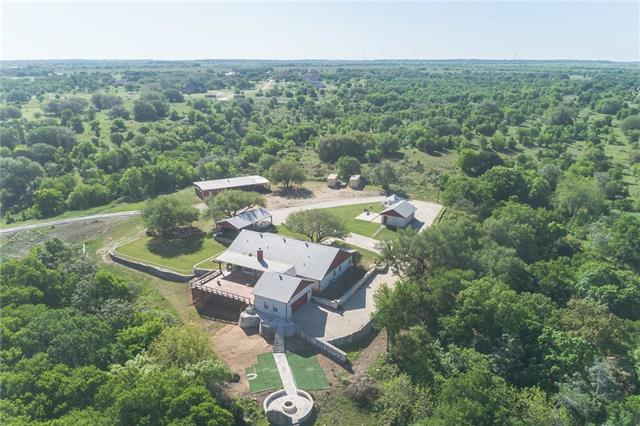 This beautifully appointed home is nestled on an absolutely gorgeous piece of property! This home offers a true retreat from the day to day concerns. Open your back door and walk out onto a deck with stunning views, perfect for entertaining. A true Texas home includes a firepit and this home has a phenomenal one. Just a stroll away from the game room. Or take a hike around your own property looking for flint pieces. This property has so many amenities there's not enough space to mention it all. COME SEE!