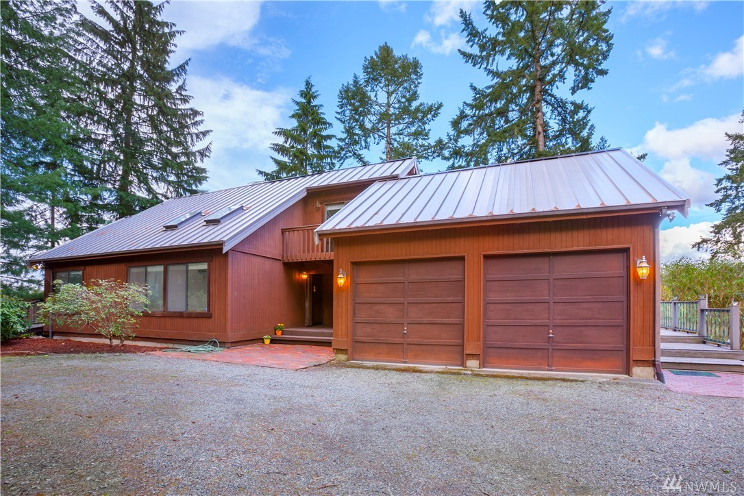 This one of a kind property w/180 degree Cascade Mt. views is a hidden oasis not to be missed. Amazing architecture, exposed wood beam ceilings, and lg picture windows give this home a warm custom feeling. Main floor features a lg bedroom w/attached 3/4 bath. lg dining room, remodeled kitchen, fam rm, and unique loft area. The upstairs boasts 2 lg bedrooms w/private decks, jack and jill bathroom, and unique catwalk The basement has a 2nd kitchen w/MIL potential, workroom and lots of storage!