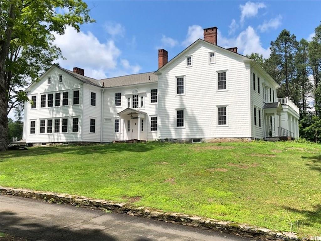 Completely remodeled to its original charm with modern updates, this 1802 Federal Colonial is rich in charm and history. This country estate is situated on nearly 10 acres of land including a bountiful blueberry farm, large chestnut barn, in-ground heated gunite pool, and surrounded by multiple stone walls. A few minutes down the road from Candlewood Lake and all of the activities the area has to offer. The house offers 19 rooms including 5 fireplaces, formal living room with fireplace, formal dining room with fireplace, masterpiece chef's kitchen, large butler's pantry, library, study, inlaw quarters, grand master bedroom and bathroom and 7 additional bedrooms. All 6 bathrooms have been remodeled to maintain original character with modern conveniences. Washer and dryer are located on 2nd floor and new mechanicals and appliances are brand new with warranties. New 4 zone efficient heating and air conditioning throughout entire home. Traditional style high efficiency windows retain elegance with current technological advances. All hardwood floors have been brought back to its original luster. Too many details to list, this is a Must See.
