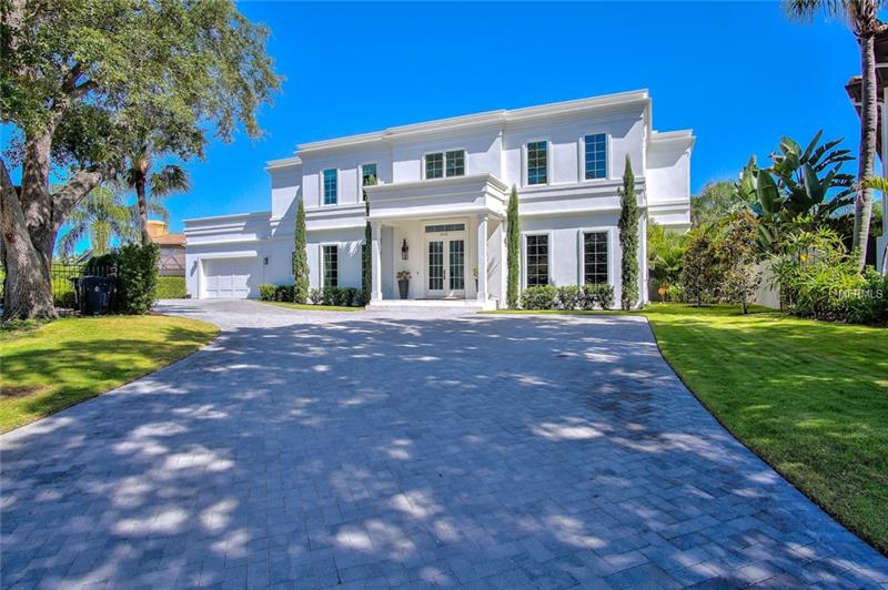 This Professionally Built & Decorated Modern Neo Classical Home designed by PIPER NAVY Interiors Defined. Exquisite, Unique, & Simply Beautiful, describes this one of kind Beach Park Isles custom home. Situated on an over sized lot in a private cul-de-sac within the Exclusive Beach Park Isles. Featuring soaring 23ft volume ceilings, custom 3ftx3ft marble slab flooring imported from Spain, custom wood paneled walls throughout, formal living and dining rooms, family room, bonus room, four en-suite bedrooms, five and a half bathrooms, gourmet kitchen with Wolf range and Subzero appliances. Luxury backyard features modern, linear pool, outdoor kitchen on 700 sq ft of outdoor marble patio.