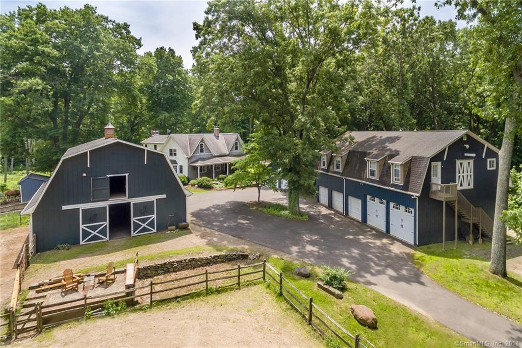 Dreaming of the equestrian life? You'll find it here at Hollie's Greenfield Hill Farm, a working horse farm poised in the tranquil Aspetuck neighborhood of Easton along the Fairfield line. Spend your morning on the wide front porch, savor the rustic charm of the post & beam farmhouse & cool off at the end of the day with a dip in the swimming pool. Cozy up with a book by 1 of 2 fireplaces, located in the country kitchen & the inviting family room. The master suite overlooks the serene landscape & a large 2nd bedroom could be divided back to create the 3rd bedroom. Over a 5-car garage, the carriage house is home to additional finished space. An additional 2-car garage is an added bonus. The horse barn houses 6 stalls, 4 paddocks, wash room, tack room & a full gambrel loft. Out for a ride? The property is home to a riding ring & 10+ acres of rolling green countryside with a pond, trails & room to explore. Welcome to a little slice of paradise.