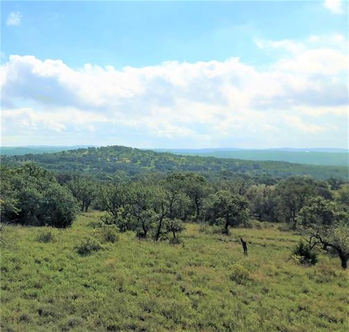Gorgeous high ground with multiple building sites to choose from in coveted Byrd Ranch. This 50.10 acre tract deep in the Byrd Ranch property off of HWY 290, close to Blanco, Johnson City, and the Texas Wine Trail. Terraced elevations, numerous stands of oak, and a breezy clear plateau at an elevation of just under 1400 feet that has several building sites with breathtaking long-distance Hill Country views. Fenced on two sides and ag, this an ideal location for livestock or a hilltop retreat.