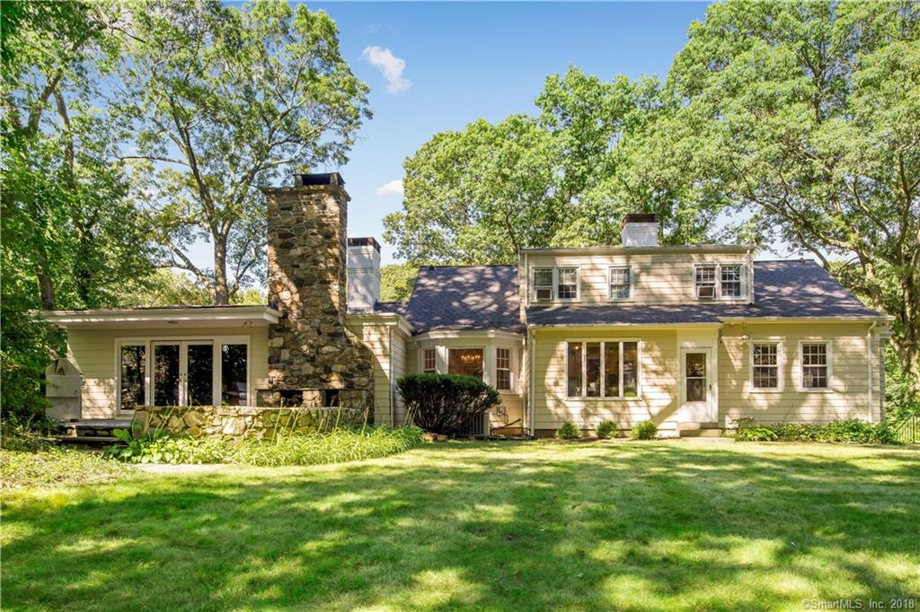 On a quiet and picturesque street in the sought after Stratfield neigborhood is this unique and elegant cape. This beauty is set on a 3/4 acre lot with mature trees and professionally landscaped grounds, offering not one but two blue stone patios where you can do all your summer entertainment. The elegant welcoming foyer leads to a bright and cheery great room with vaulted ceilings and wood burning fireplace. After the great room you a very special family room showcasing a stone fireplace where you can spend cozy game nights with family and friends, here you can also find wall to wall custom concealed closet doors and access to the beautiful patio and backyard through large french doors. A sun-filled and formal dining room awaits, great for the holidays and special occasions. Next, is the eat-in  kitchen overlooking the beautiful grounds with granite counter tops and SS appliances. The spacious master bedroom on the first floor and an additional bedroom presently being used as an office. Finishing up the first floor are 2 full baths and a den that offers unique vintage wet bar that is sure to be a hit when entertaining. The second floor features two more bedrooms and a double sink full bath, offering privacy for a growing family or guests. The two car garage with direct access to the partially finished basement is the icing on the cake of this very unique home. Built-ins, oversized windows, two fireplaces, and many more charming characteristics makes this home like no other!
