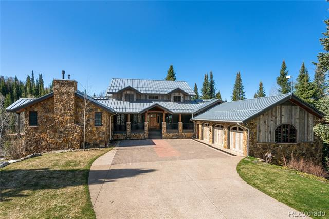 Nestled above Strawberry Park, this luxury 7,798 sq. ft. custom estate provides privacy only 2 miles from downtown Steamboat. Extensively renovated in 2015, this lavishly designed 6+ bedroom, 4.5 bath home is located on 18.54 acres. The home's gourmet kitchen designed by Ullr Designs includes pro grade appliances, soapstone counters, and an island breakfast bar. The spacious great room has access to the patio with hot tub and outdoor kitchen. The lower level is perfect for entertainment with a large recreation room, wet bar, and a cork floored gym. The garage is an extra-large 3 bay and deep enough to park large trucks. For the equestrian, the property provides a gorgeous 2,175 sq. ft. barn with power, 10 ft. doors, and ample storage for stalls or equipment. With views of Strawberry Park, Emerald Mountain, and Howelsen Hill, this Strawberry Park jewel delivers the comfort of accessibility with the feel of a tranquil mountain retreat.