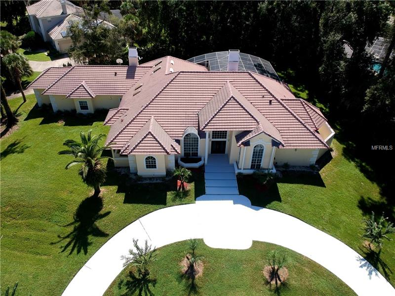 down price .Beautiful Home  4 Bedroom,2 bath, Formal Living Room with fireplace, Formal Dining room, Family Room with fireplace, Study With  fireplace,kitchen with granite, cooking island , appliances stain steel. Master Bath with Jacuzzi and granite, pool ,enclosed porch, Jacuzzi, Wet kitchen , bar, fresh painting , porcelanato floors, laminate floor, intercoms, 3 car garage, workshop. In excellent place, Next to the Shopping centers,  near to the I4 . in excellent gate community.