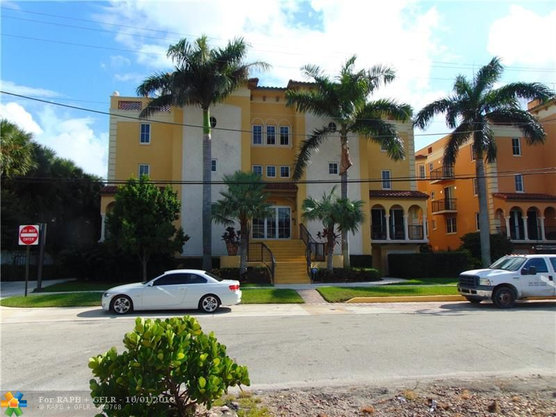 Stunning open & spacious floor plan with great water views located in Hemingways Landing a boutique building in desirable Rio Vista.  Deeded 34 Ft boat slip behind condo. Easy ocean access. No fixed bridges. Close to intracoastal.  Attractive foyer leads to kitchen with Viking appliances & gas stove, snack bar opening into dining area & great room. There is a private master bedroom with gorgeous en-suite bathroom, two cedar walk-in closets & direct access to terrace. Two additional bedrooms are en-suite. Split bedroom plan affords privacy. Half bath and laundry room are conveniently located. Motorized blinds in great room & Master bedroom. Impact windows and doors throughout unit. Amenities: ground level pool, hot tub, barbecue. Unit has Two parking spaces with elevator access from garage.