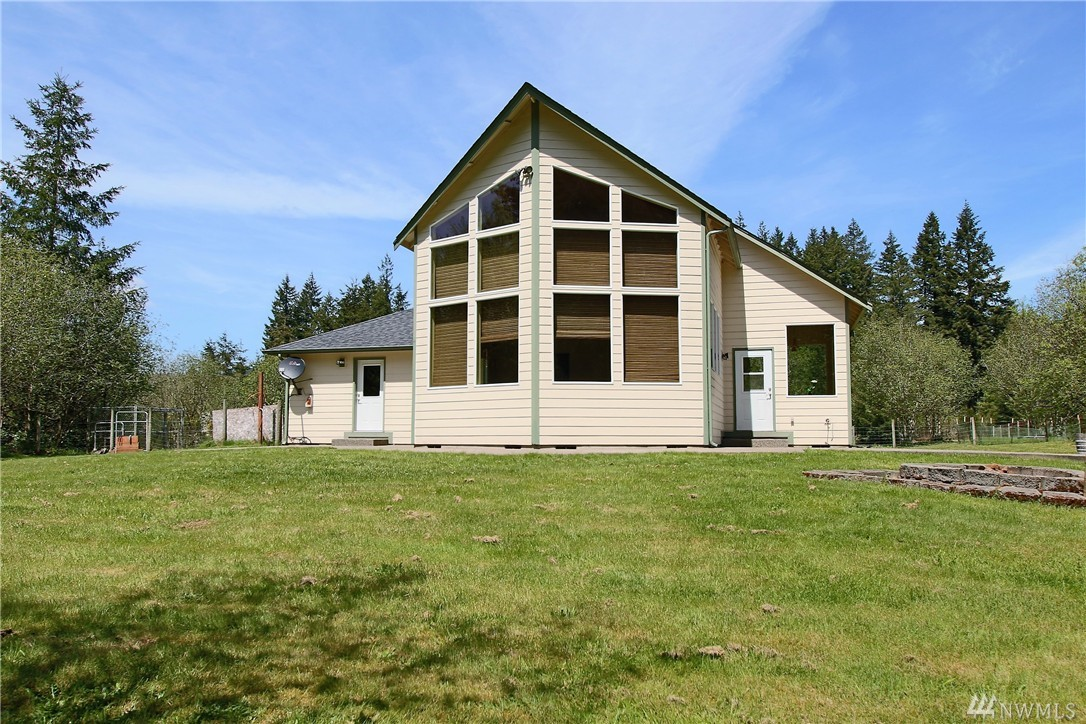MOTIVATED SELLER!! Beautiful 3-bdrm home, nearly 2100 sf, on 6+ acres. Great room w/wood vaulted ceiling and wall of windows looking out to private backyard! Gas range, raised breakfast bar, and plenty of counter space. Nice hardwood floors on the main level. Master Suite w/5pc bath, walk-in closet, vaulted ceilings. 3-car garage + lots of room for RV Parking, Heat Pump, Air Filtration System, and wired for generator! Garden space, big fire pit off patio, peaceful setting in Tumwater Schools!