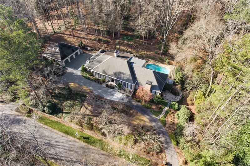 Beautifully renovated home in one of Buckhead's most wonderful neighborhoods. 100 yards from the entrance to the Chattahoochee River Park, with miles of trails and 400 acres. Stunning new kitchen is open to a large family room, bar area, informal dining, and an absolutely beautiful custom solarium. Spectacular master on main with 2 sitting areas, separate his/hers bathrooms & separate his/hers closets. Basement is finished as large entertainment space w theater, game area & bar. Guest apartment with kitchen over 3-car garage. Simply unmatched!