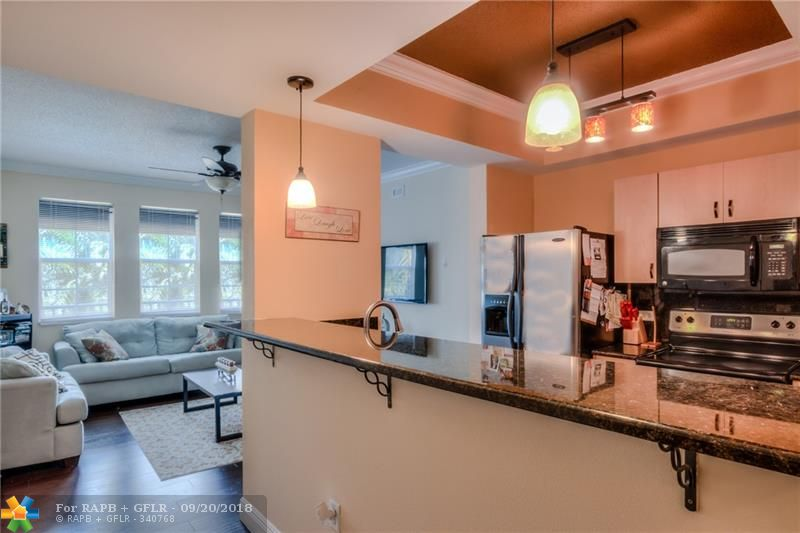 UPGRADED 2 BEDROOM/2 BATHROOM LOCATED IN AN UPSCALE FORT LAUDERDALE BUILDING. WOOD FLOORS THROUGHOUT THIS BEAUTIFUL CONDO, NO CARPET. THE KITCHEN IS EQUIPT WITH GRANITE COUNTERTOPS, BAR/BREAKFAST COUNTER AND PLENTY OF STORAGE. FULL SIZE WASHING MACHINE AND DRYER LOCATED WITHIN THE UNIT. TENANT TO RECEIVE TWO (2) SECURE GARAGE PARKING SPACES. RESORT STYLE AMENITIES INCLUDE POOL, JACUZZI, BBQ AREA, FITNESS CENTER, INDOOR ENTERTAINING AREA AND MORE. WALKING DISTANCE TO EVERYTHING - LAS OLAS, RESTAURANTS, BARS, SHOPPING, DOWNTOWN, AND PARKS!