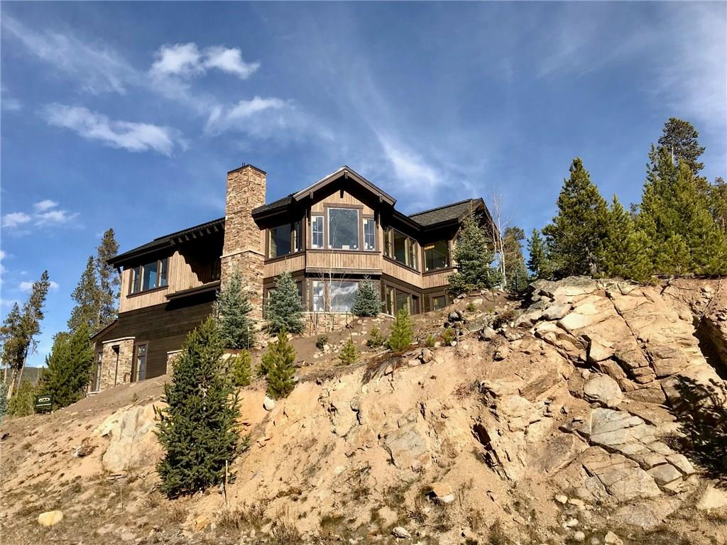 This new Suzanne Allen designed home rests on an impressive granite outcropping with absolutely commanding views of the Tenmile Range down to the Breckenridge Ski Area! The centralized floorplan design is ideal for multi-generational living with en-suite bedroom convenience and the latest is luxe finishes & appointments. The outdoor living space is privately tucked away out of the elements, protected by a rocky granite ridge and you will revel in the all day sunshine and extraordinary views.