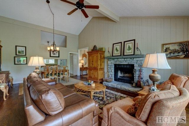 Unbelievable value in Highlands Falls Country Club! Easy, one-level living with an open floor plan. The cozy living room is complete with a wood-burning fire place and a wall of sliding glass doors with easy access to the expansive deck.The spacious kitchen features lots of counter and cabinet space. Both the large master suite and guest bedroom have deck access. This lovely Golf Villa is move-in ready and an excellent buy!   Furnishings are negotiable.