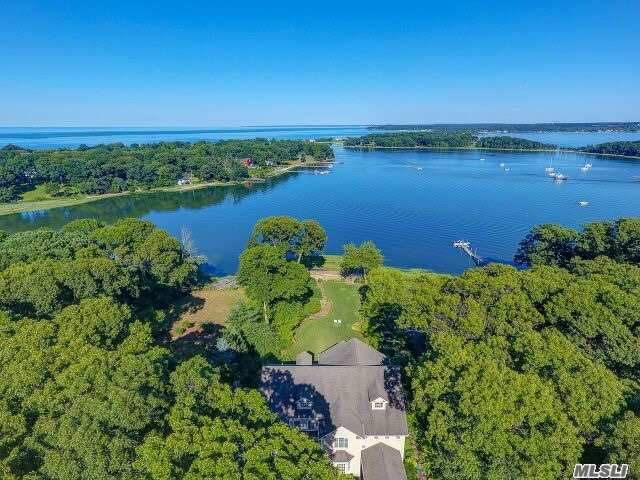 Rare Offering!Secluded 1.43 Acres,Stunning 7000 Sq Ft Custom 2004 Waterfont,130'Beachfront On Duck Is.Hrbr,Exquisite Gardens,Bluestone Expansive Front N Back Patios,Ipe Decks,Porches,Principle Rooms O'looking Water.Stainless Steel Railings,Whole House Radiant Heat Incl Bsmt N 4 Car Gar.,Professional True Chef's Eik,3 Fp's,Incredible Superb Custom Millwork&Coffered Ceilings,Mstr Ste W/Fp,Grand Sitting Rm,Luxurious Mstr Ba,Whole House Generac Generator, Lovingly Designed In Nature To Be Treasured.