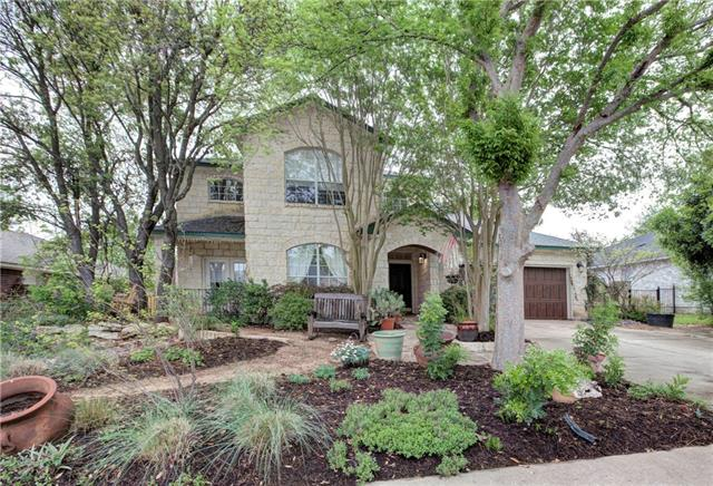 Updates galore! Custom Gourmet Kitchen boats a Thermador Range with 2 ovens, custom cabinets, extended breakfast bar with granite countertop, & plumbed automatic self-grinding Mele coffee maker. Hardwood downstairs and Bamboo upstairs. Stone fireplace with built in bookshelves & computer station. 2 zone HVAC system w/programmable thermostats. Downstairs guest room w/ full bath. For the outside, large covered patio with a built in smoker, synthetic turf and putting green and native & low water use plants.