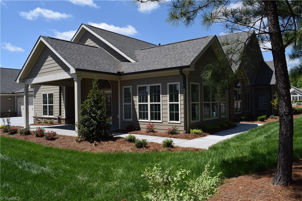 This open and  spacious Canterbury floorpan  offers custom finishes throughout. Vaulted ceilings with beams  in the living room  and coffered ceiling in dining room to match, tray ceiling in master.  Stunning sunroom with windows galore. Custom Cabinets, Stainless appliances, and granite countertops throughout. Enjoy relaxing on your covered screened  porch, swimming in the community pool, working out in the fitness center, all in your very low maintenance exterior home.*Photo represents new construction