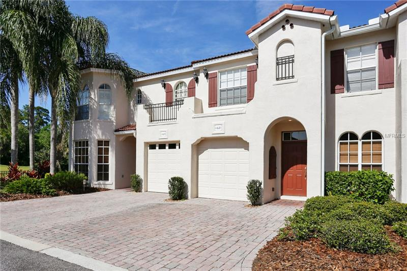 """WESTCHASE WOW!! This 3 bedroom, 2.5 bathroom townhome in the gated community of Saville Rowe is absolutely gorgeous. Exceptional inside and out, this townhouse is located directly across the street from the community clubhouse for convenient access to the quiet swimming pool and entertaining area. Enjoy amazing, sweeping views of the manicured grounds and ponds of Westchase Golf Course from the comfort of the screened lanai. Beautiful ceramic tile and volume ceilings throughout the first floor welcome you into this modern, yet inviting space. Master suite with expansive """"flex"""" space provides more than enough room for a home office, nursery, or exercise equipment. Large walk-in closet, attached garage, and parking to accommodate at least two cars makes storage easy, and living convenient! Entering the neighborhood past the golf course and picturesque streets is a treat, while updates to the interior including chef's kitchen boasting all stainless-steel appliances, light fixtures, wall to wall paint, bathrooms, and water heater - all installed between 2016 & 2018 - make for a truly turn-key, MOVE-IN READY home! Exceptionally located near shopping, entertainment, and all of the remarkable amenities that Westchase has to offer, and with a distinctively resort-like feel, this is gem of property is one that you will LOVE to call home!"""