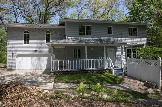 Bring Us an OFFER.  Seller wants this one SOLD. HUGE REDUCTION. LAKEFRONT w/17 wooded acres (some wetland) in Orion Twp. w/frontage on all sports Elkhorn Lk. Original owner. It keeps getting better:Exterior walls are a double 2 x 6 walls = 12'' thick! minimal utilities; many updates in 2017-18: painted thru out interior; a/c & furnace; carpet in LR, DR,& LIB. Flooring: entry; 1/2 bath/kitchen; upper baths.Exterior doors; light fix.; all appliances in main kit & laundry; tile on FP & hearth; vanities & sink in 1/2 bath & LL bath & so much more.  LL is set up for in-law quarters with separate entry & laundry hook up. There is also a large three season room overlooking the beautiful woods. Multi-tear composite decking; City water. Blue Prints included in sale along with landscaping prints.  Why drive 3-4 hours North each weekend when you can come home everyday to your own private nature preserve. Blue Ribbon award Lake Orion Schools.  BATVI