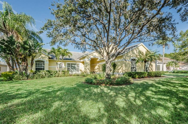 Bayou Club Estate home located on interior lake.  Four (4) bedroom and three(3) full baths with oversized three (3) car garage and bird caged pool/spa. Lowest priced estate home with 3067 square feet of living area.  Open layout with volume ceilings gives a spacious feeling, 3 way split bedroom plan for privacy of family or guests. Contemporary decorative beams in kitchen ceiling. Expansive parking and driveway with turn around area for this side entry 3 car oversized garage.  Formal living room, dining room and family room.  Inside laundry with utility sink. View of lake from master bedroom, dining room, breakfast area, 3rd bedroom and family room. Covered deck area, screened pool and patio overlooking the lake.  Convient pool bath for easy use from pool area. Lake has beautiful fountain that makes for a peace setting in the back yard.