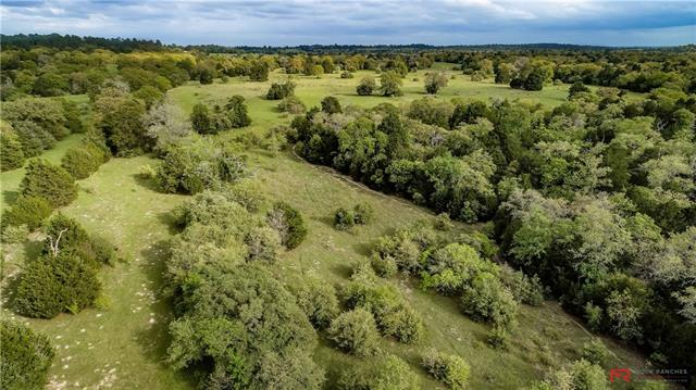 Ranch Attributes: -Mature hardwoods -Good native grass for grazing livestock -Superb hunting -2 stock ponds -2 water wells -Electric in place -1-D-1 ag tax exception -Quality Fencing -Beautiful elevation changes -No floodplain