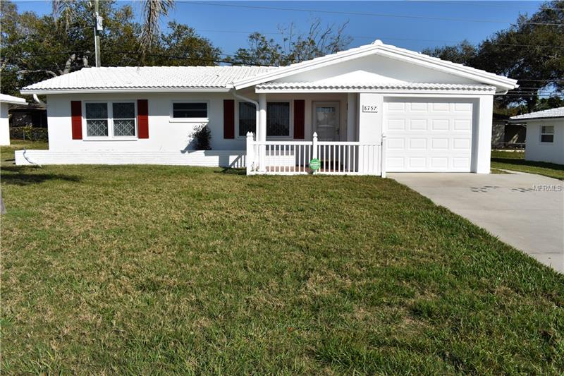 Welcome Home to this beautiful 2BR/2BA/1CG well maintained home. This lovely home is in the highly sought-after Tamarac By the Gulf Community. Step inside and be amazed at the open spacious flow of this wonderful home with lots of storage! The kitchen is the center of this lovely home with eating space plus dining area and access to the family room. This home features 2015 Tile Roof, 2015 A/C, 2008 Windows, updated kitchen and bathrooms plus wood flooring throughout, and much more. Tamarac by the Gulf is an active 55+ community with many activities, heated pool, club house, shuffleboard and billiards. Centrally located near the new Seminole City Center, lots of shopping, restaurants, Publix, close to the bus line schools and BEACH. Call today!