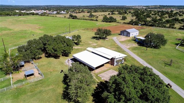 Horseman's Dream Place!!!! 33.75 Acres located minutes from Marble Falls.  This amazing property includes:  *cute 2 bed 2 bath house *6 stall horse barn with 3 more outside stalls with automatic water's and large feed and tack room *2 bed 1 bath with laundry room apartment with garage *2400 sq ft metal shop with office and 1/2 bath *Lighted roping arena, horse walker *2 Wells *Pipe fencing and electric gate *Coastal Field