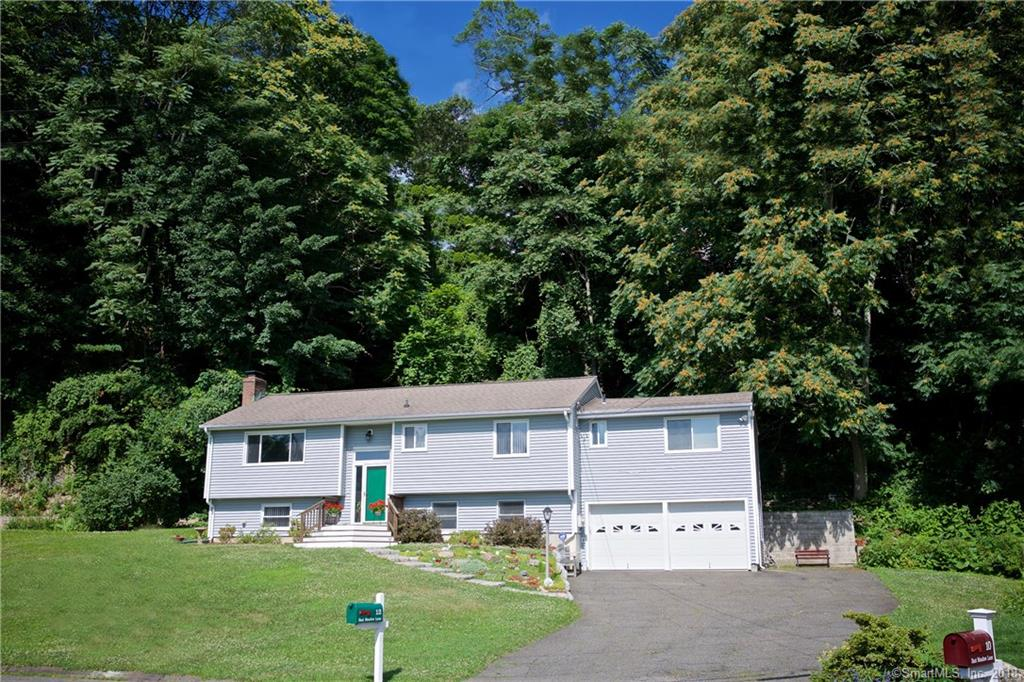 Location, Location!!Spectacular raised ranch in sought after East Rocks area at the end of a cul de sac. This well maintained home has it all! Living Room with formal dining area, new appliances in kitchen, gleaming hardwood floors, new decks, 2 car garage, Master BR has custom built ins, full bath, sliders to private deck and vaulted ceiling. 4 bedrooms and 2 full baths on main level. Lower Level has a family/living room with fireplace, summer kitchen, full bath, and 2 additional rooms, could be perfect in-law apartment. Freshly painted throughout...move right in.