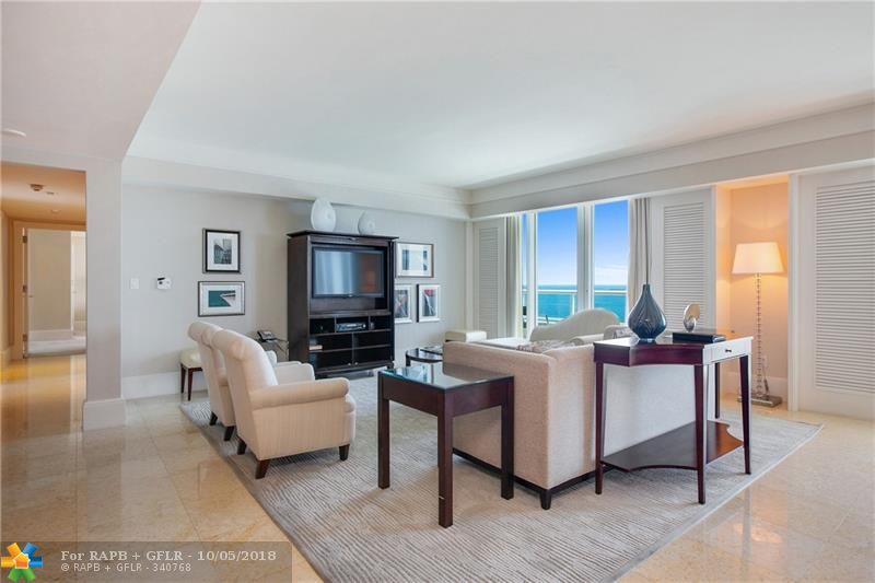 Infinite and direct Atlantic Ocean views sparkle from every room of this Southeast corner unit Condo-Hotel. Three bedroom condo-hotels are rarely available. The full kitchen with Thermador and Subzero appliances allows for dining in or live the luxurious 5 diamond hotel lifestyle by dining in one of the Ritz-Carlton's restaurants. World class hotel service, staff and amenities delight within the everyday experience of luxury resort style living. Spa, boutiques, pool and pool bar, valet, room service and concierge are only some of the cherished amenities. The terrace runs the length of the condo, the Master bedroom is spacious with a large closet, the 2nd bedroom is en-suite and there is a locking owners closet. No black-out dates or maximum days in the hotel rental program.